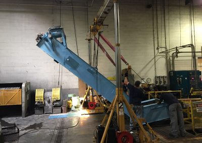 Removing a heat treating conveyor system for belt replacement