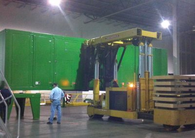 Setting a 55,000 lbs Blue Box Recycler onto frame with our 50 Ton Tri-lifter